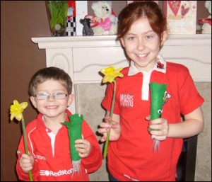 Adorable Welsh children planning your downfall
